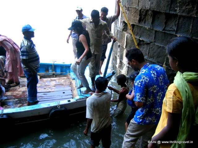Jumping across the entrance at Murud Janjira
