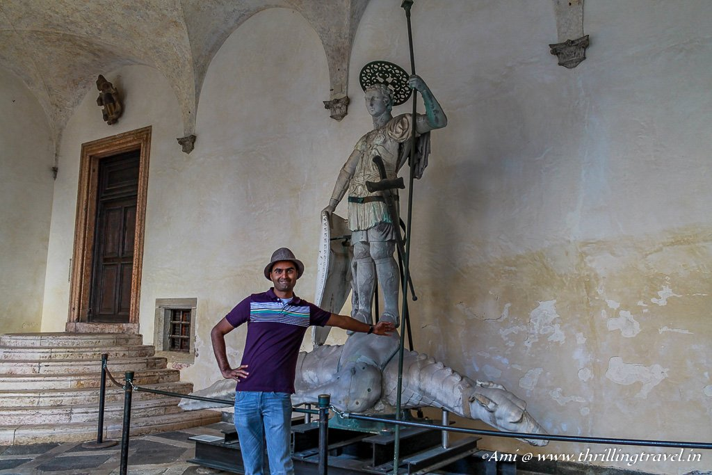 Posing against the Original Statue of St Theodore and the Water Dragon