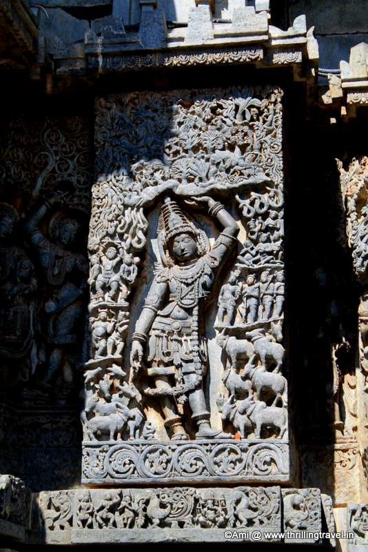 Krishna lifting Govardhan- on the walls of Hoysaleswara temple, Halebid
