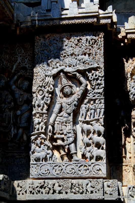 Krishna lifting Govardhan- on the walls of Hoysaleswara temple, Halebid