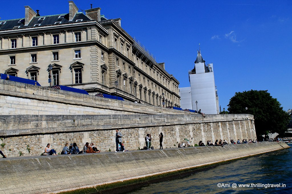 People relaxing along the banks of the River Seine, Paris