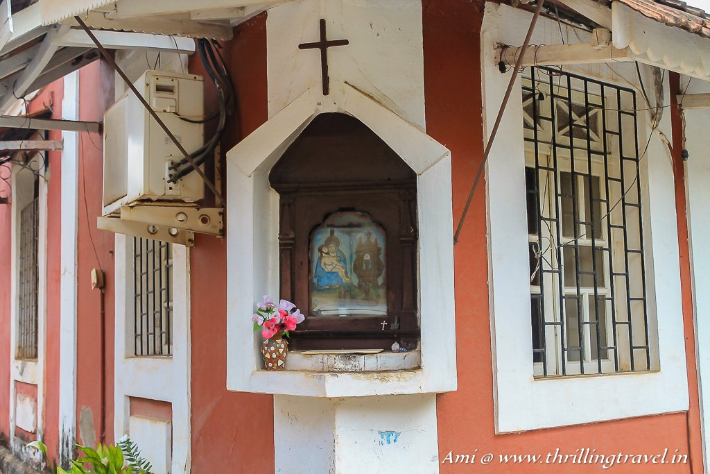 The cross indicates a Christian home in Fontainhas