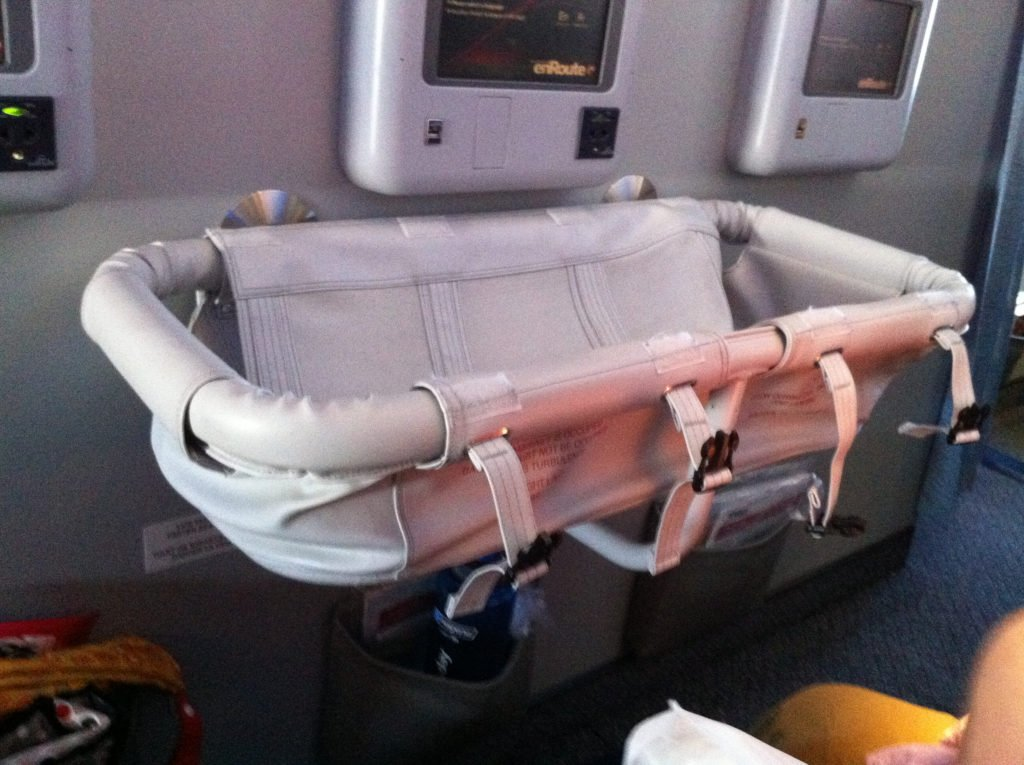 Bassinet seats in a flight when traveling with kids Image credit: Jim and Laura via Flickr, under CC 2.0