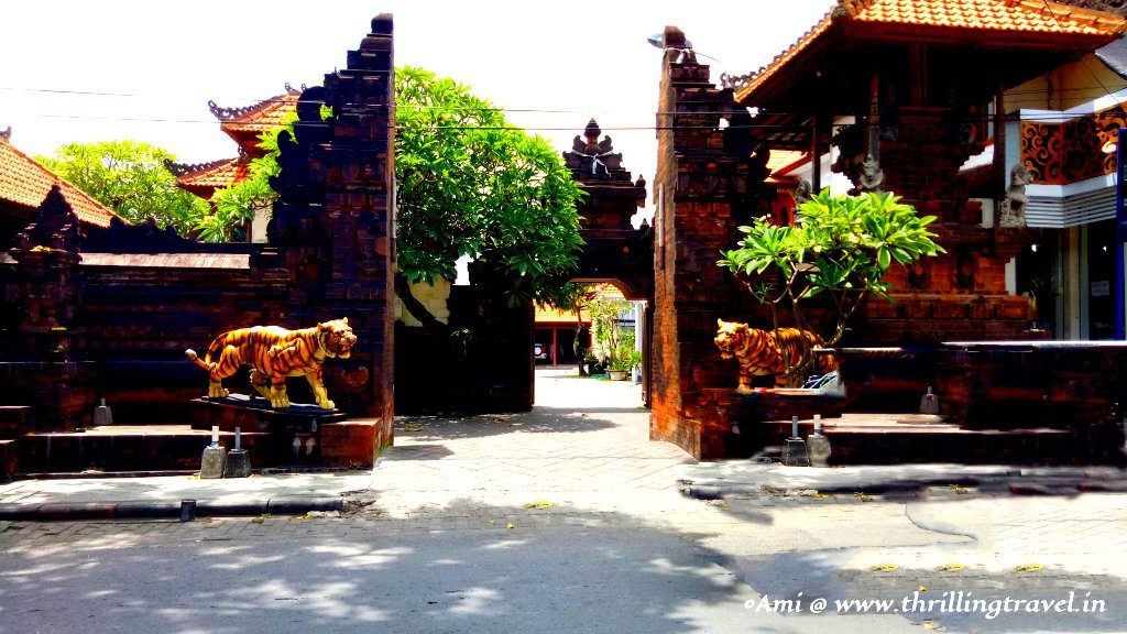 A Balinese home with tigers guarding the home and the compound temple within