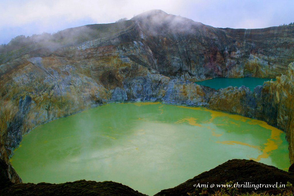 The Green Lake of Young Men and Maidens at Kelimutu Mountains