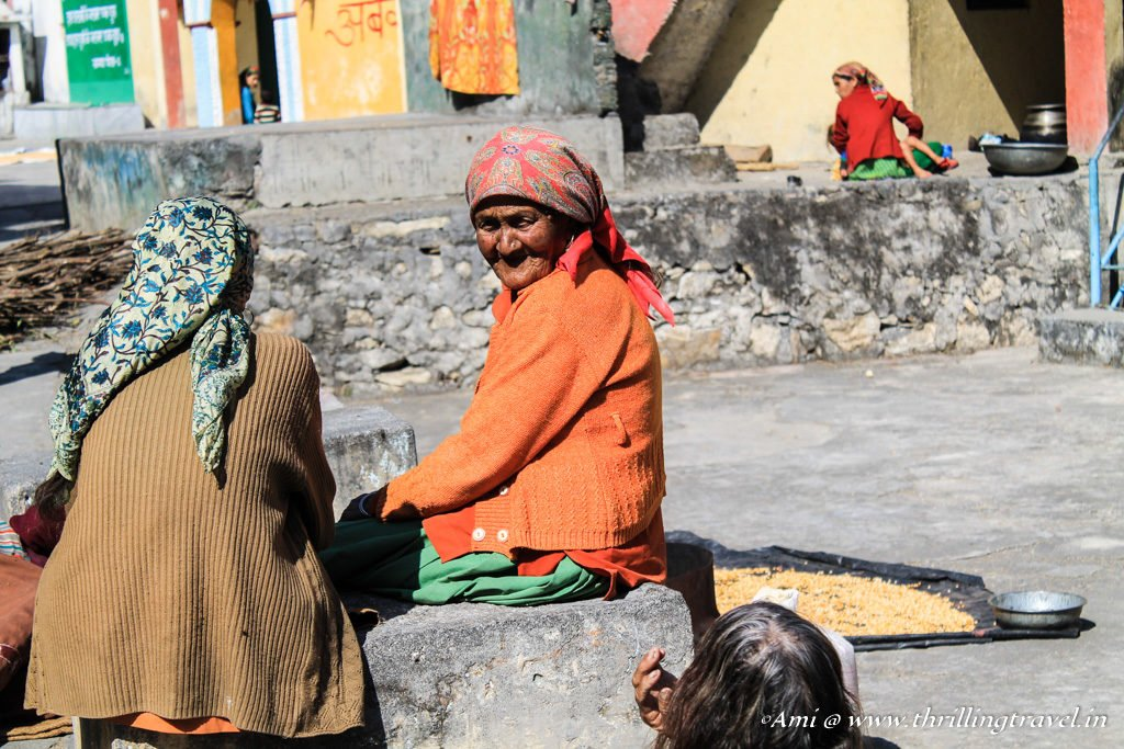 Old lady sitting along with her friends in the corn village of Sainji