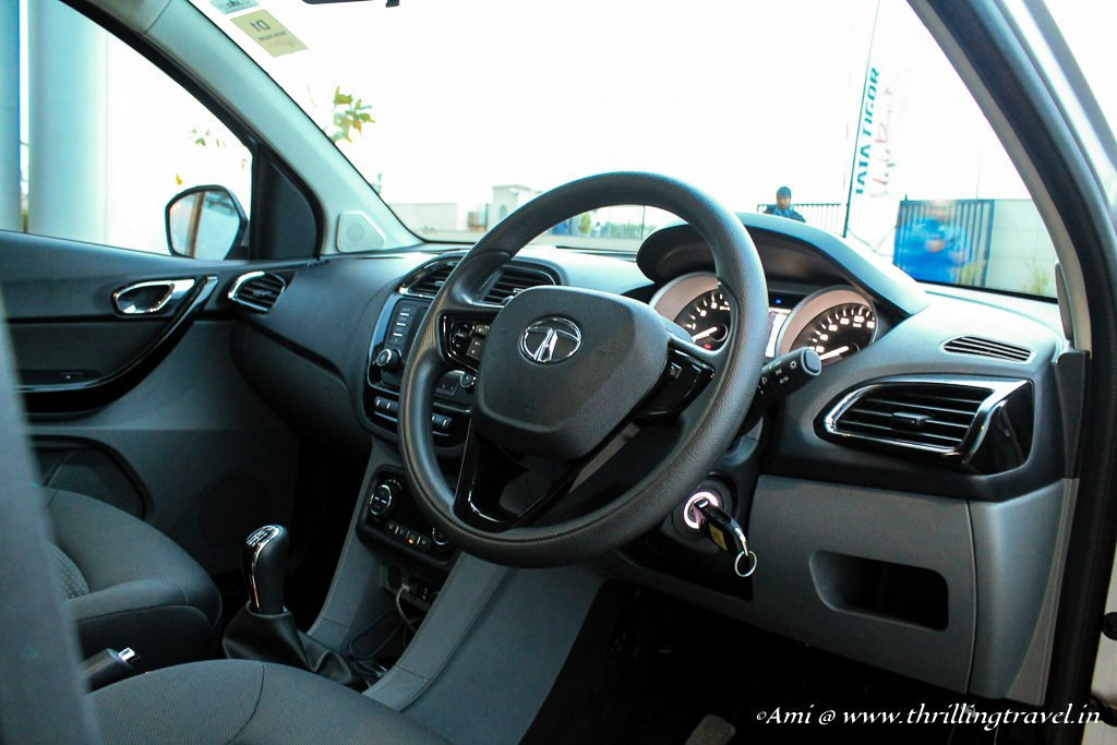 The steering wheel with all the controls of Tata Tigor
