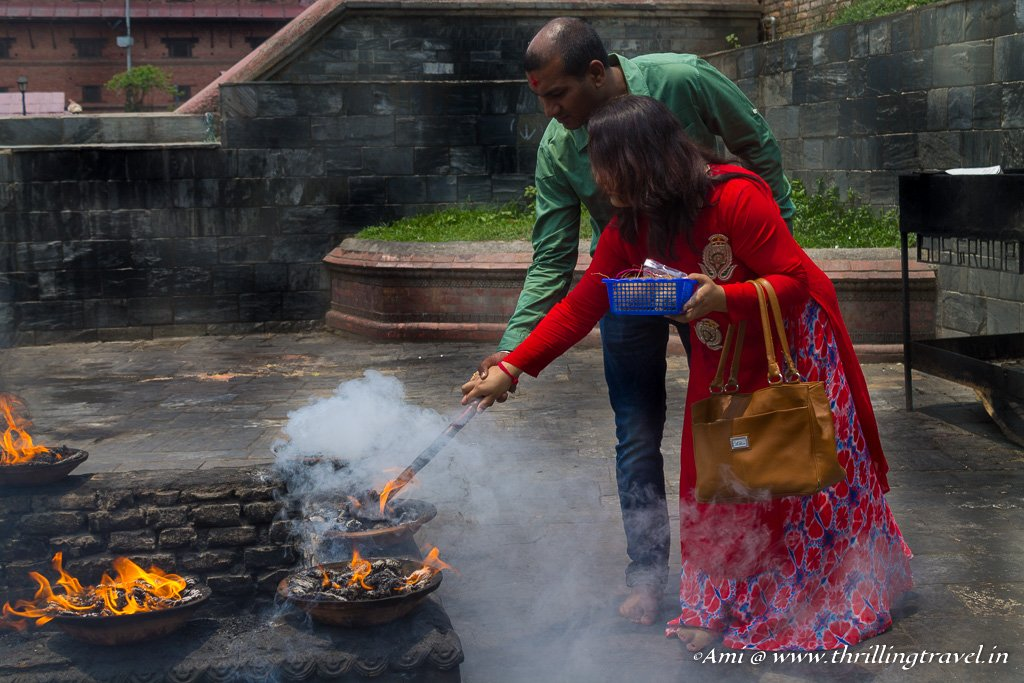 A couple completing their wish ritual at Pashupatinath temple