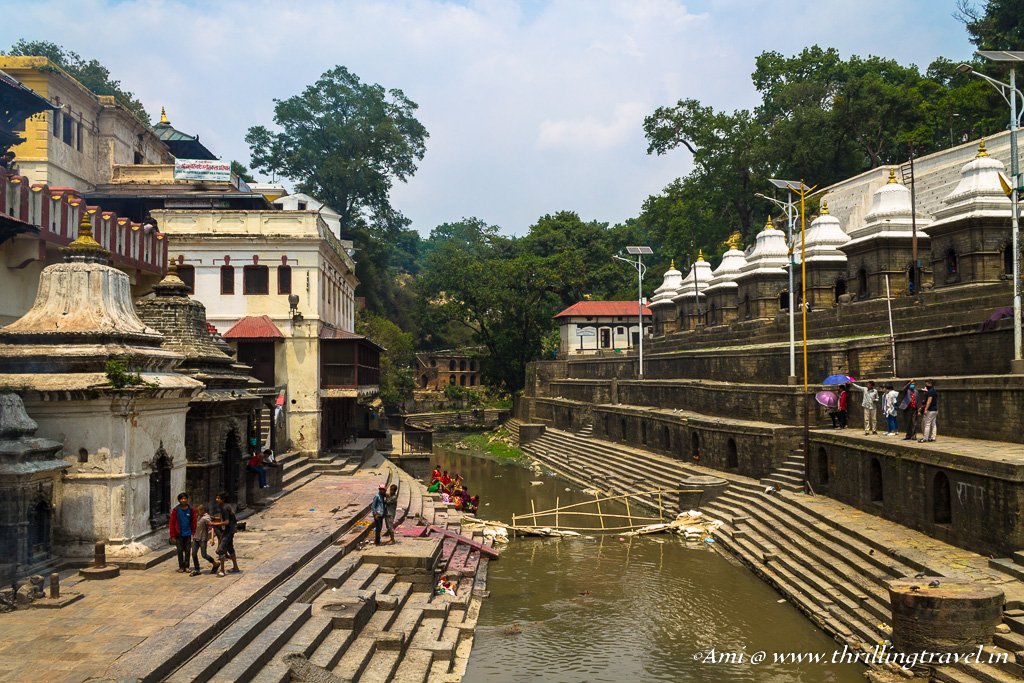 The cremation pyre area around the Bagmati river. On the left is the Pashupatinath temple, on the right are the smaller shrines made for the royalty
