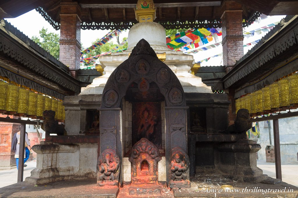 The Saraswati temple surrounded by the Buddhist Prayer Wheels