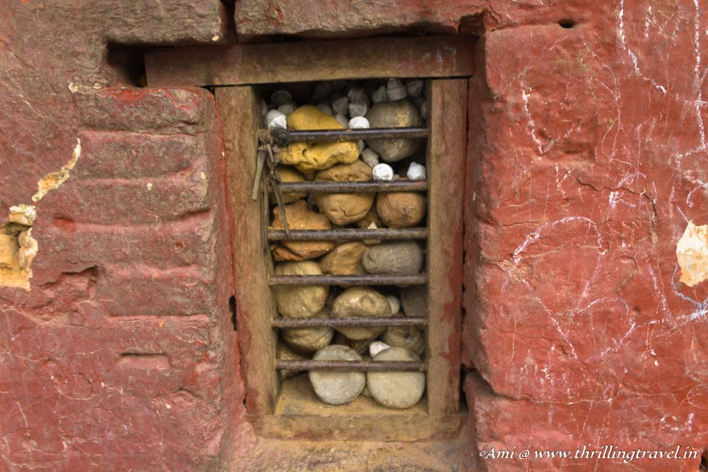 White capsules containing the Ashes amidst the stones
