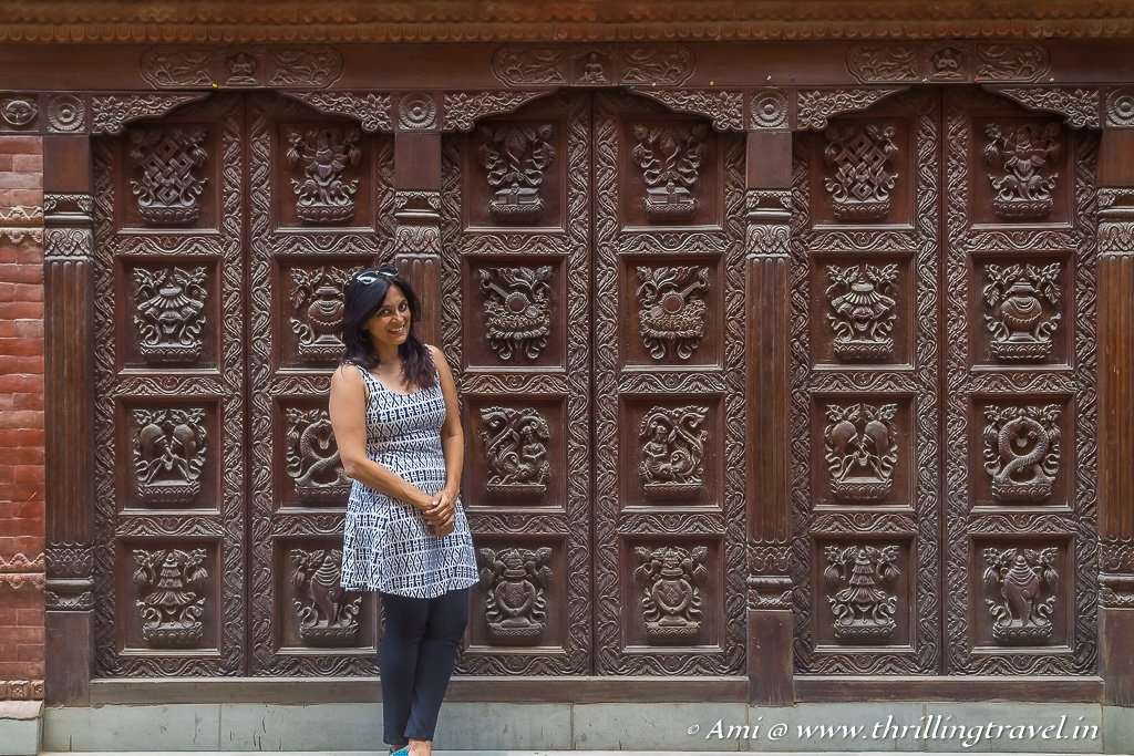 Posing against the Newari Doors in Patan Square Nepal
