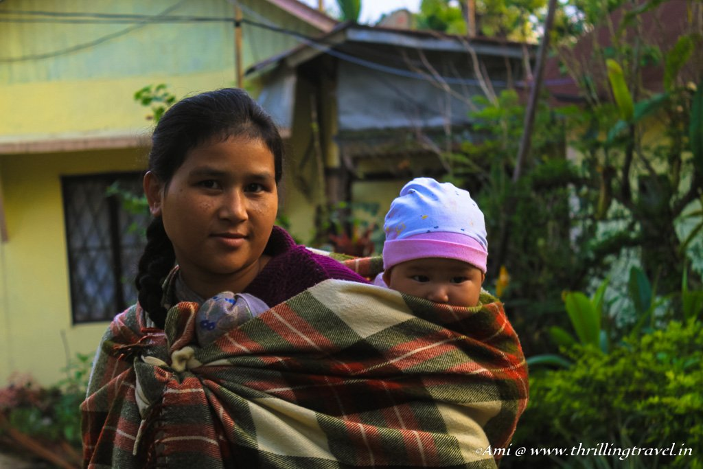 A Khasi lady in Mawlynnong with her baby in the traditional dress