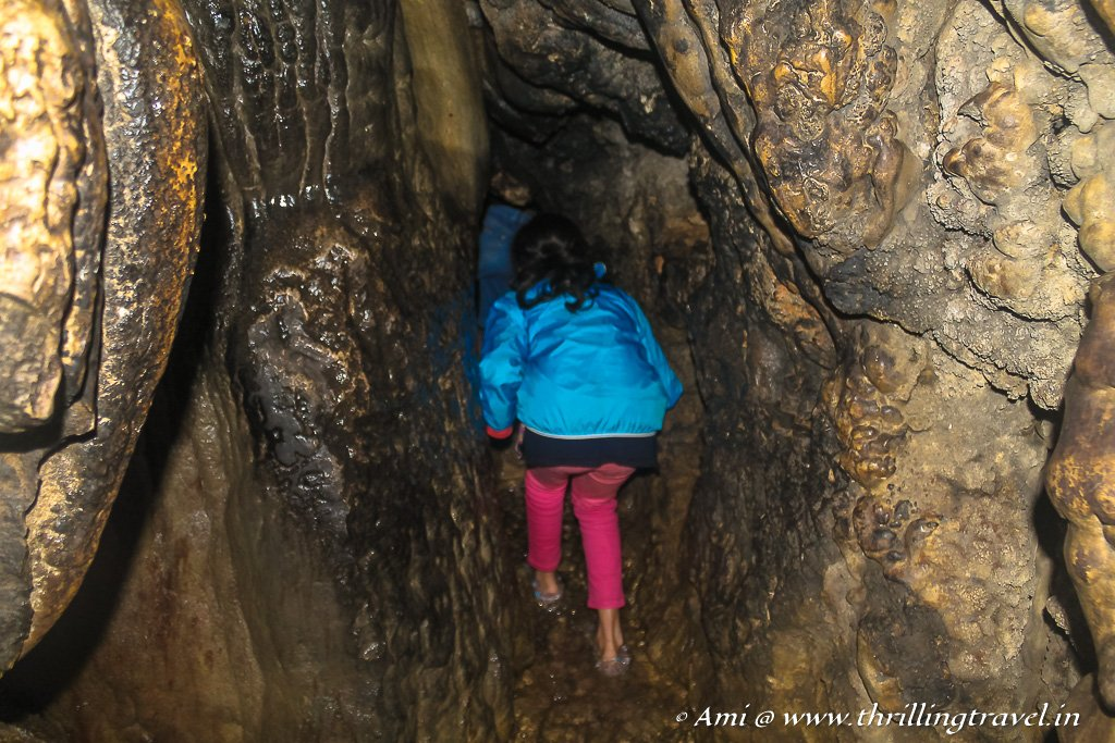 Squeezing through the Epiglottis into the belly of the Mawsmai Caves in Meghalaya