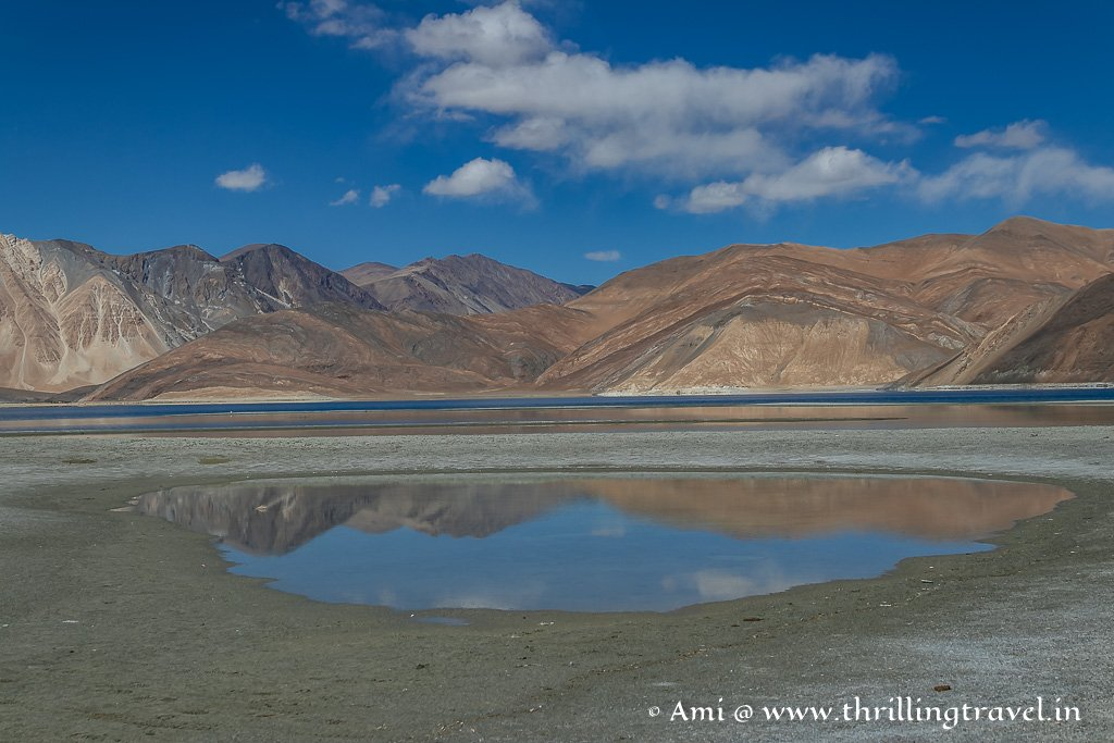 A piece of the sky and the mountains in the still waters around Pangong Lake Ladakh