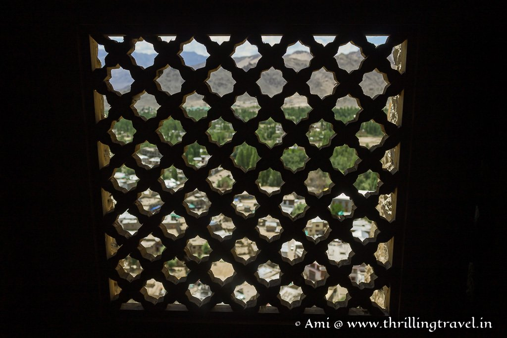 The lattice windows used by women to watch the celebrations in the royal courtyard of Leh Palace