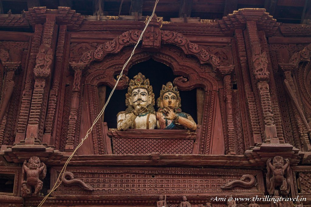 Shiva Parvati statues staring out of the window of the temple
