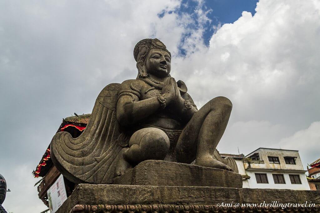 Garuda facing the collapsed Trilokya Mohan Narayan temple
