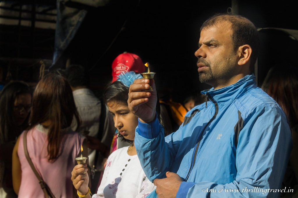Offering prayers for the deceased at Indra Jatra