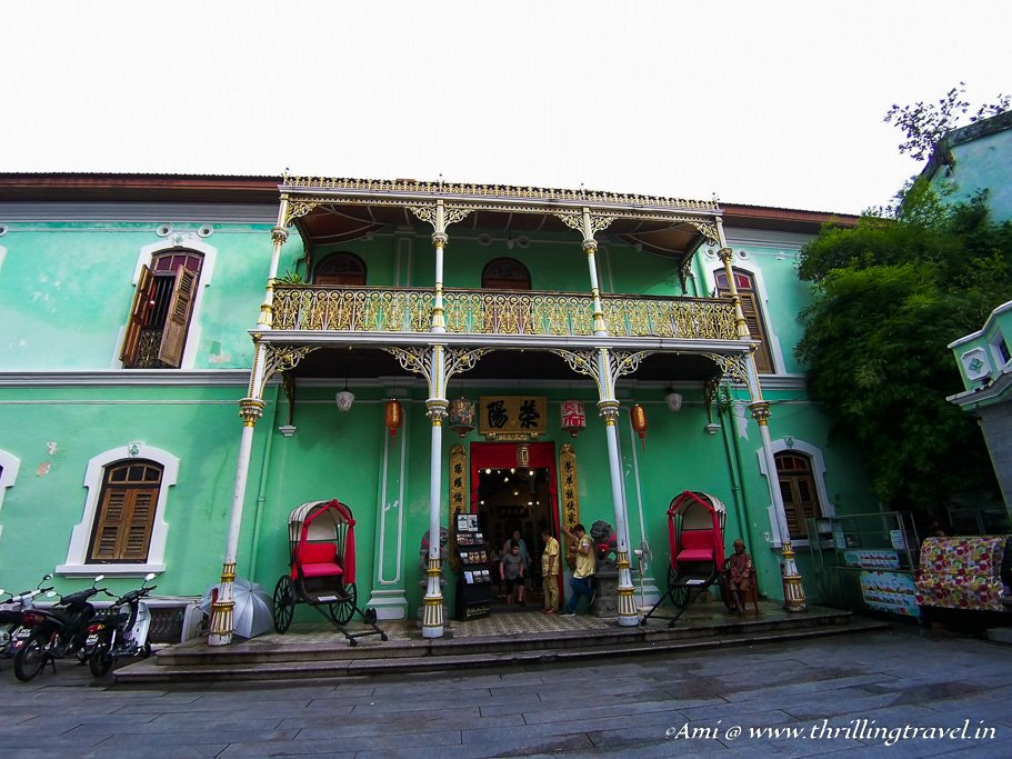 The side entrance of the Pinang Peranakan Mansion with its Victorian balconies