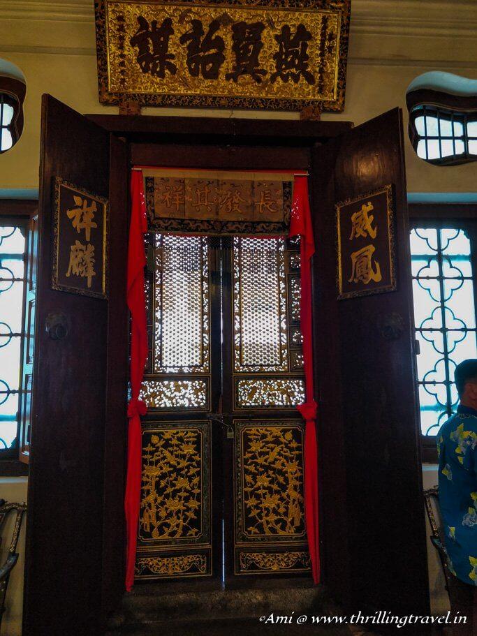The main doors of the Pinang Peranakan mansion from inside