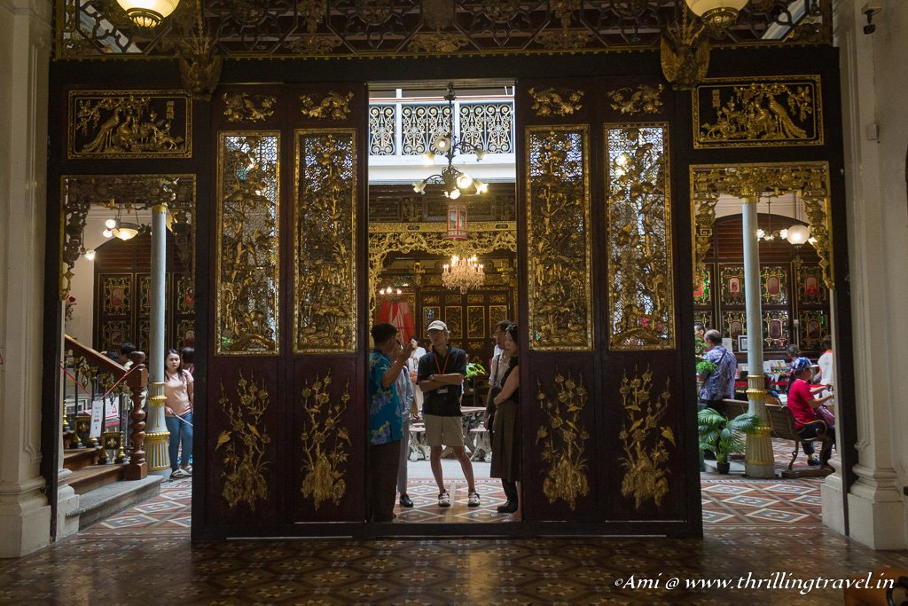 The wooden partitions around the Pinang Peranakan Mansion