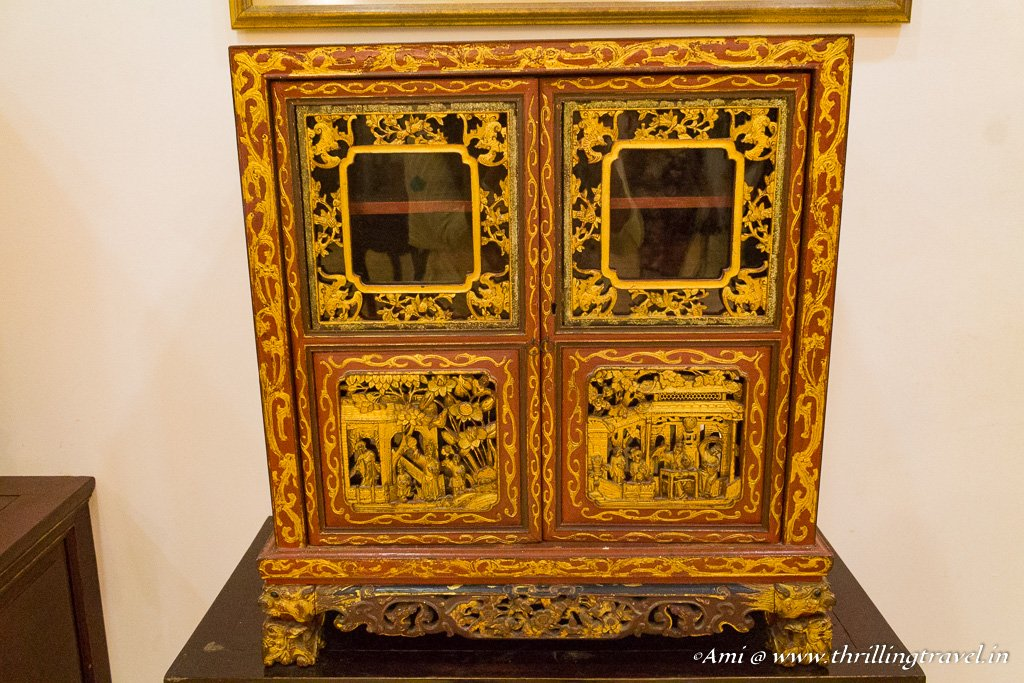 Stories carved onto the cupboards of Pinang Peranakan Mansion