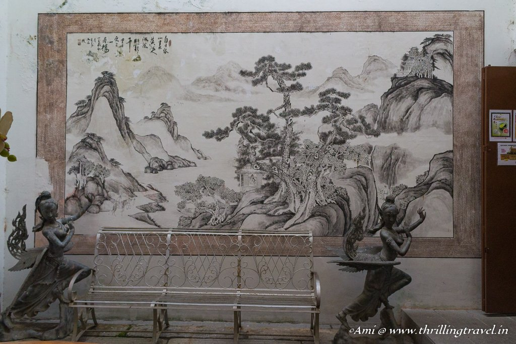 Entrance to Nonya's Kitchen with its Chinese painting and European statues