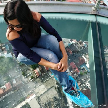 Walking on glass at Rainbow Skywalk in Komtar Penang