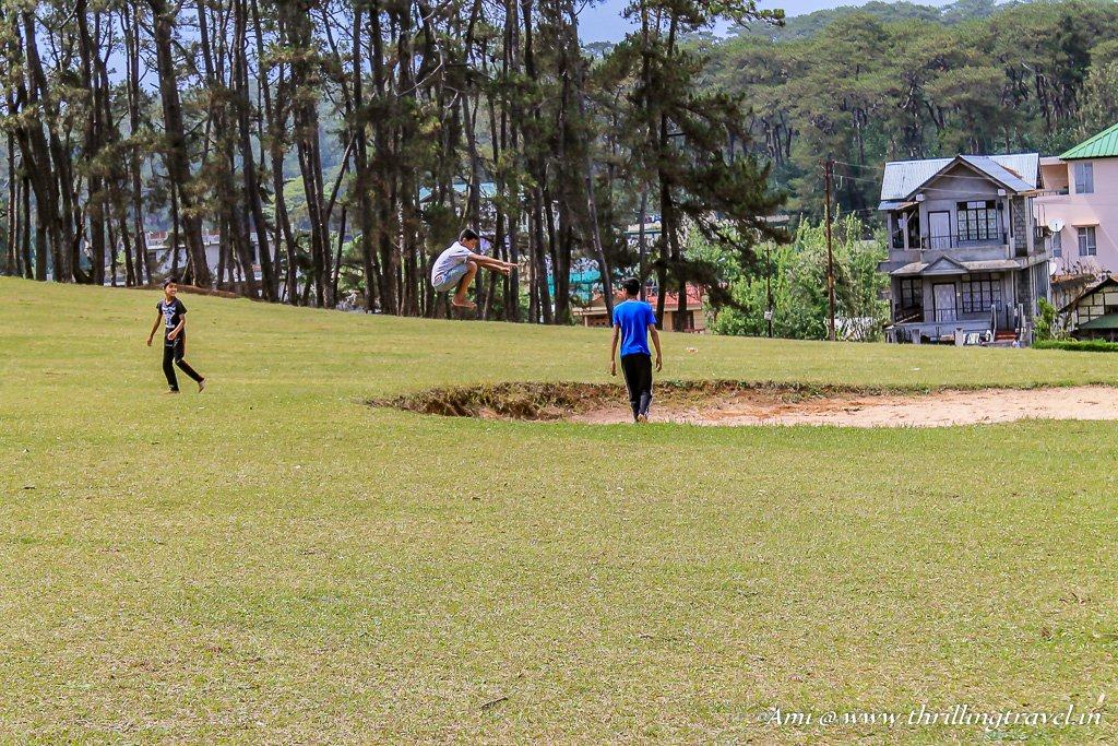 Kids trying out somersaults at Shillong Golf course