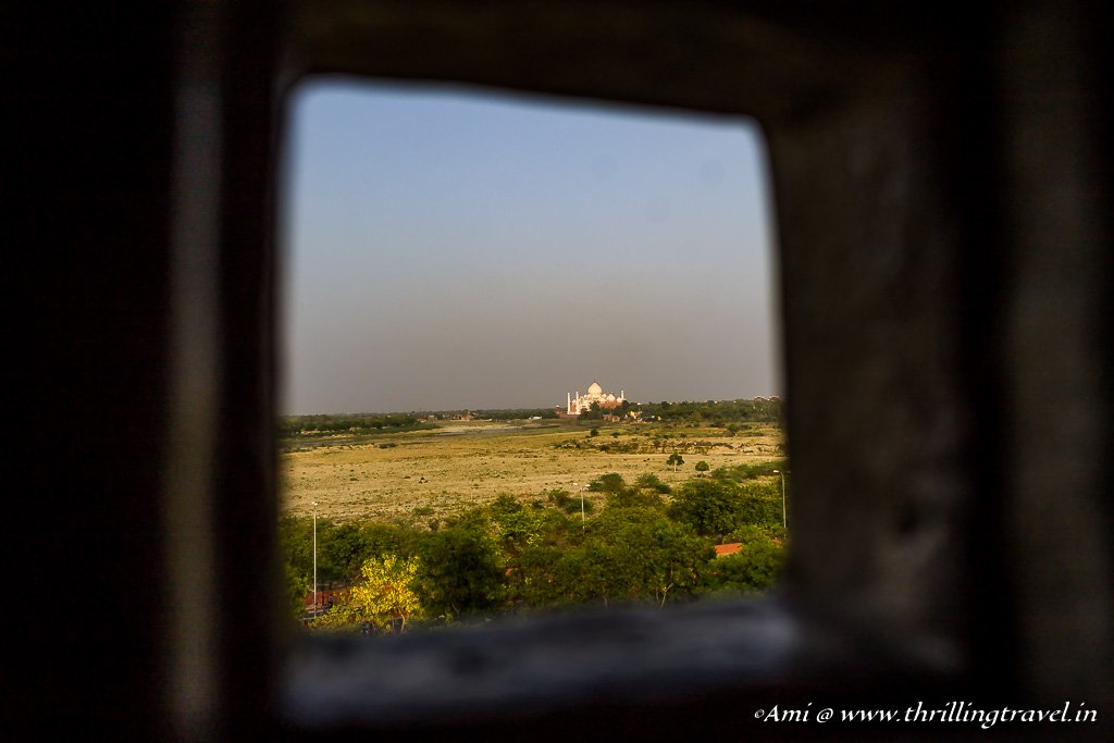 A glimpse of the Taj Mahal from the Khas Mahal Jhali windows at Agra Fort