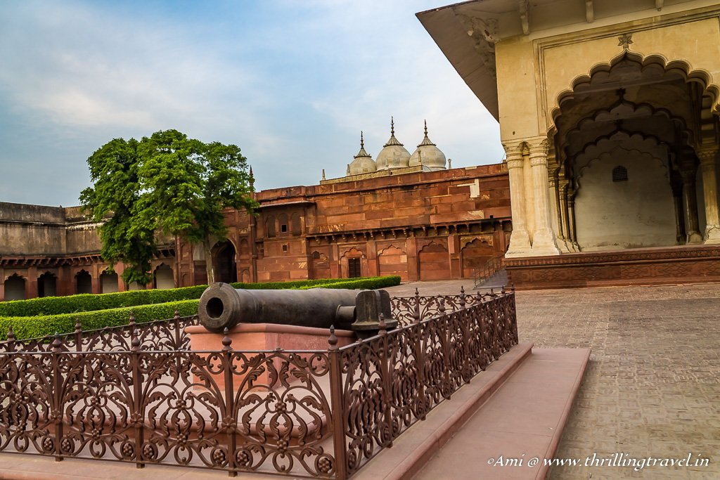 The British Cannon and a glimpse of Nagina Masjid behind it, Agra Fort