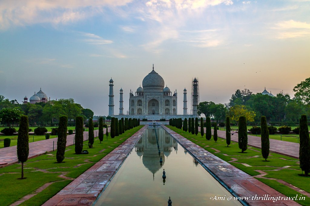 Charbagh with the perfect reflection of the Taj Mahal at dawn