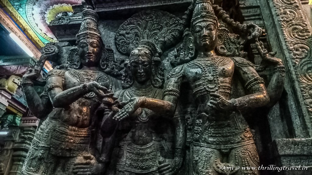 Goddess Meenakshi in the center with Lord Sunderswara on the right and Lord Vishnu on the left