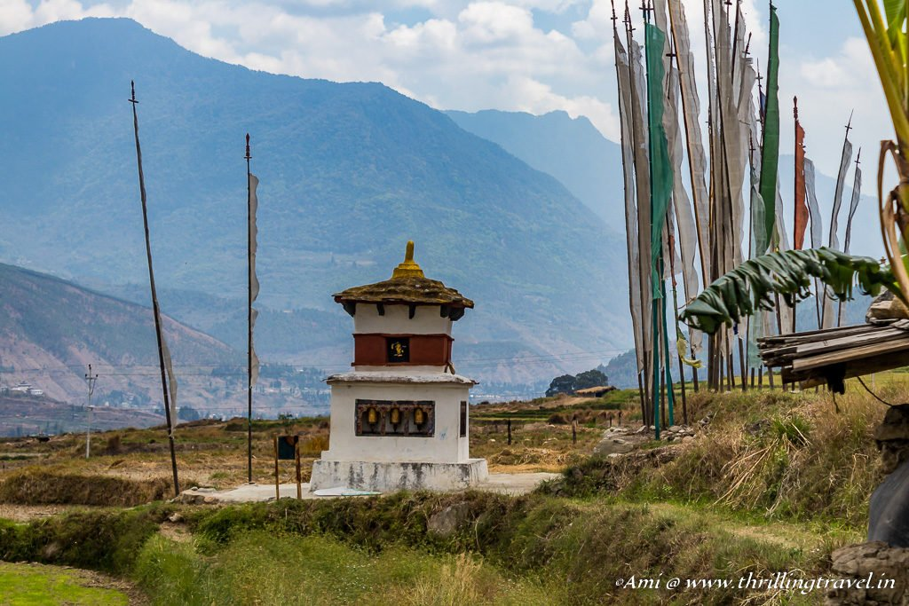 Prayer flags and Chortens amid the Paddy Fields, enroute to the Fertility temple