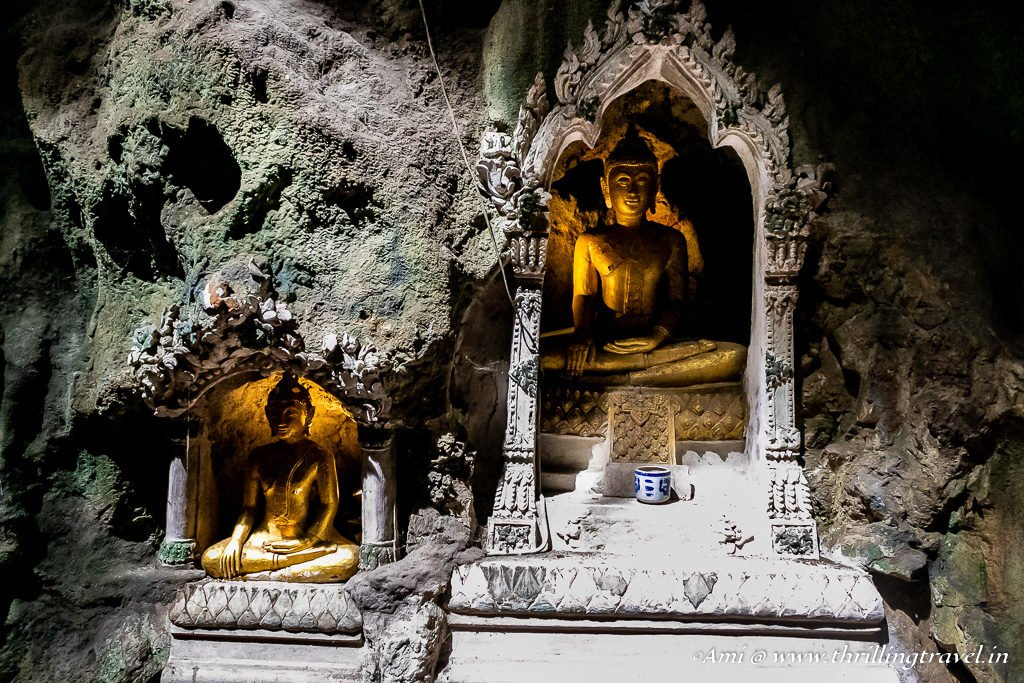 Idols along the walls of Khao Luang Cave