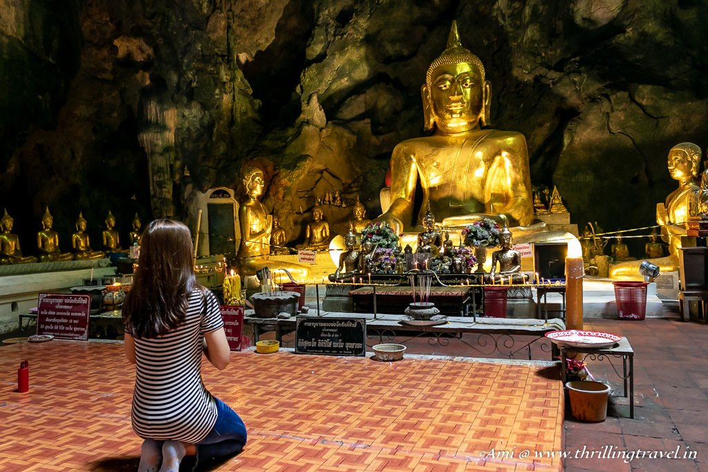 Praying to the main Buddha in Khao Luang Cave Temple