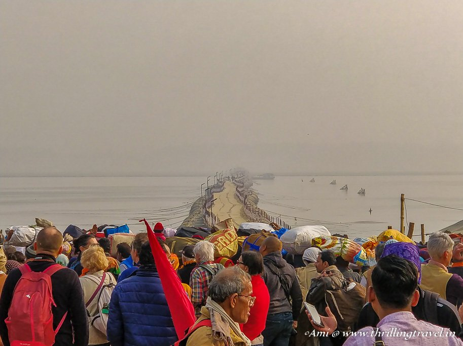 As the crowd awaits the opening of Bridge 19 to cross over to Kumbh