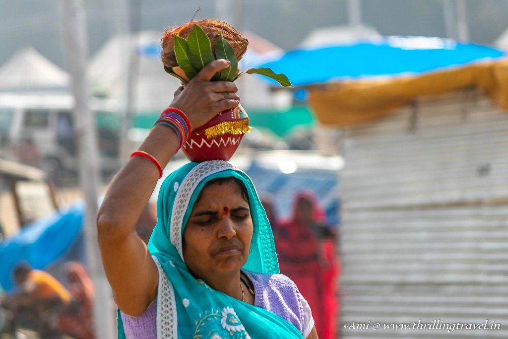 Woman carrying a Kumbh at the Mela 2019