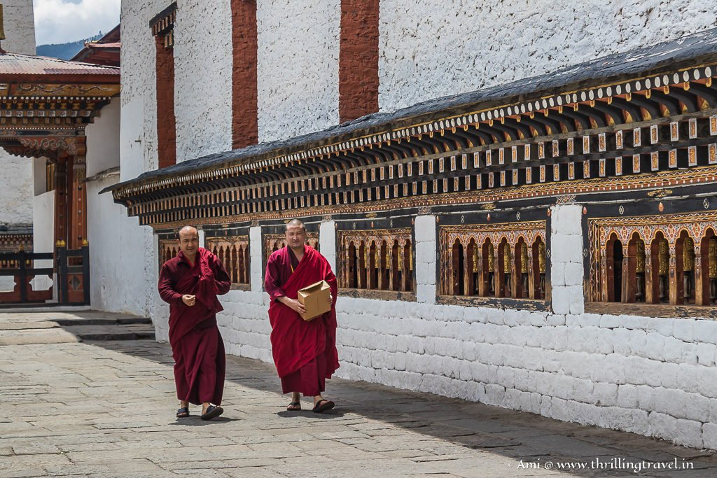 Monks walking along the Prayer wheels at Thimphu Dzong