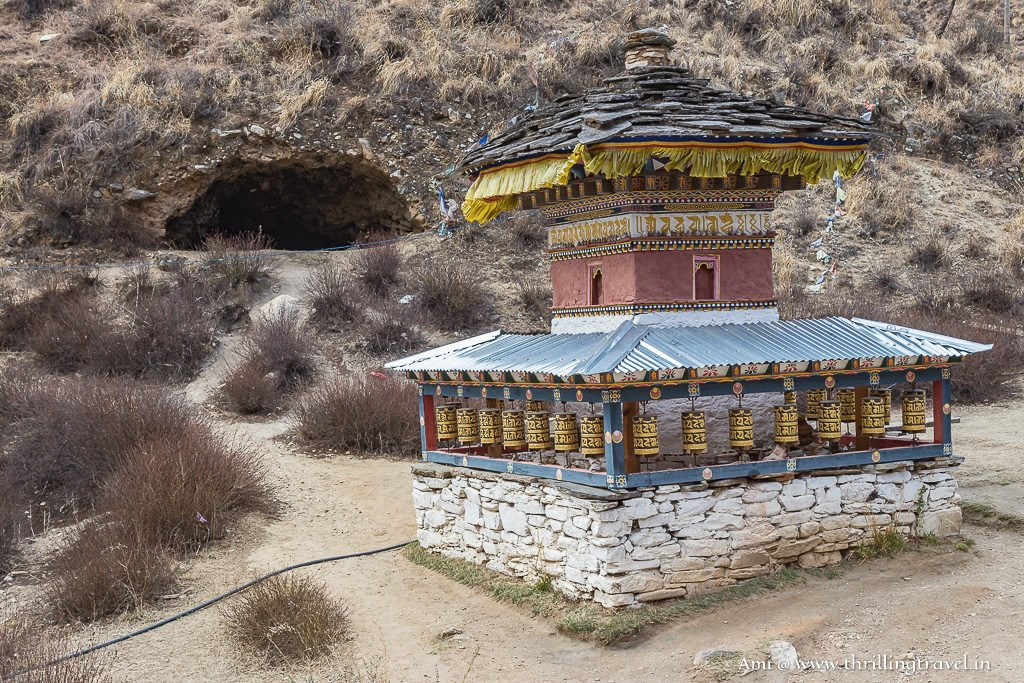Prayer Wheels by the iron bridge along with the cave in the background