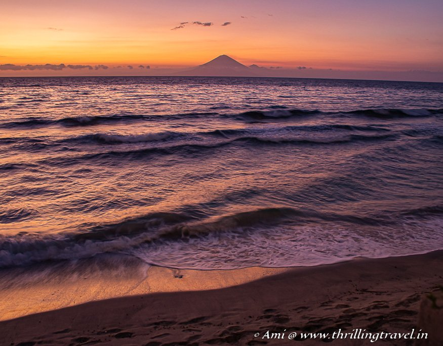 Mount Agung across Sengiggi beach at Sunset