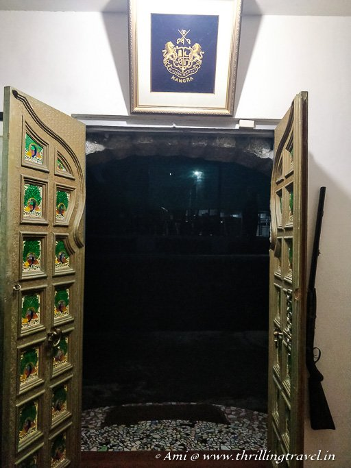 The pretty doors and crest at Sansar Chand Museum