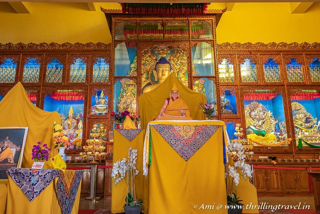 The seat of Dalai Lama with the Buddha Padmasambhava in the background