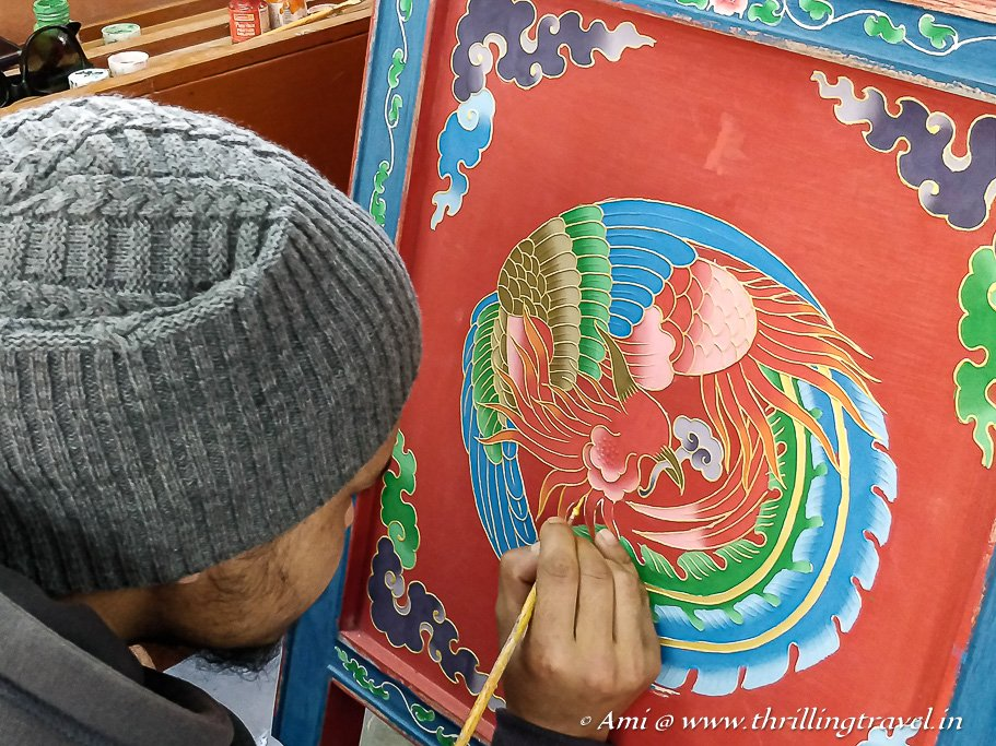 Final touches to the Tibetan Wood Painting at Norbulingka