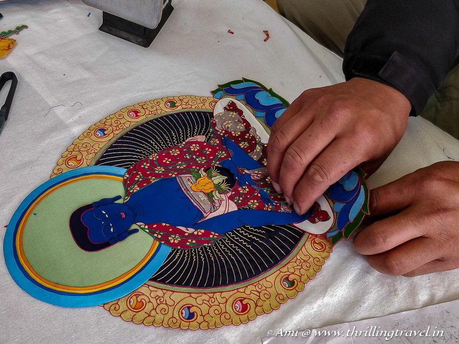 A Thangka Applique being made at Norbulingka Institute