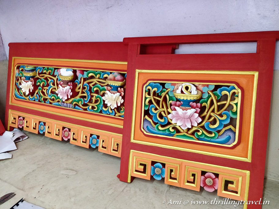 Wood painting done on the previously carved wooden artifacts