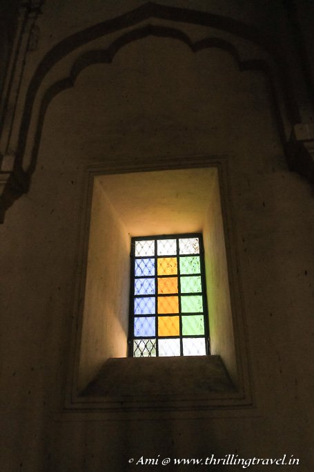 Colored glass window in the Swarga Vilasam