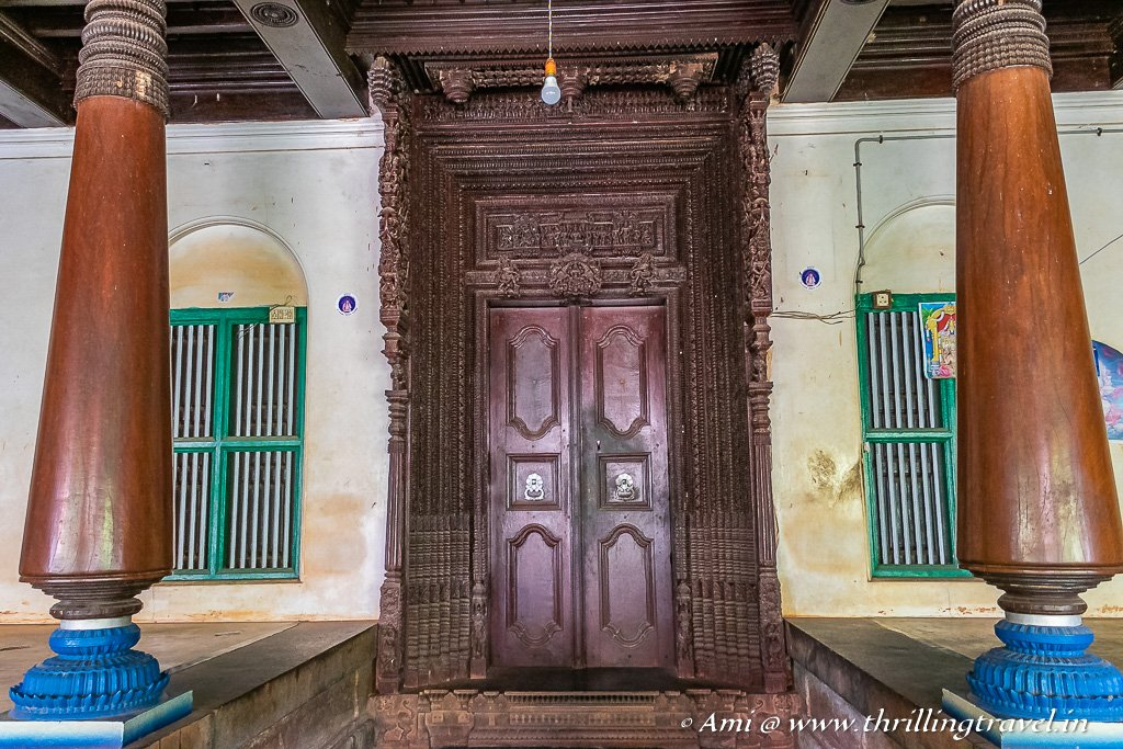 Burma Teak wood door that leads into the threshold of a Chettinad mansion