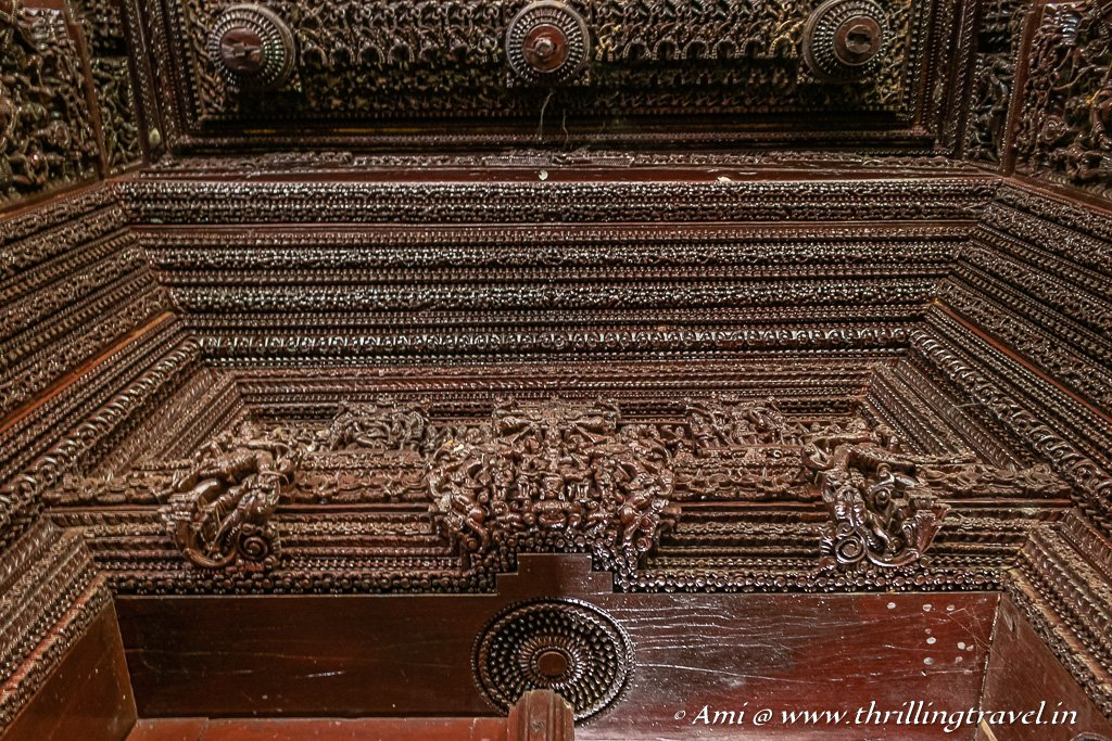 Intricate carvings on the door frame of a mansion in Chettinad